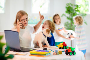 Mom telecommuting in busy house
