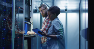 IT Support being given by a Technician in Network Closet