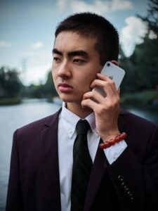 Man In Suit Outdoors Speaking On Cell Phone