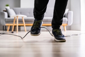 Tripping over a power cord - Not Safe workplace Tech