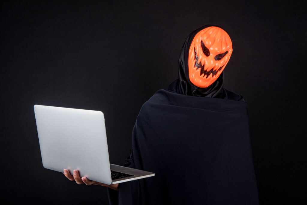 Hacker in pumpkin mask